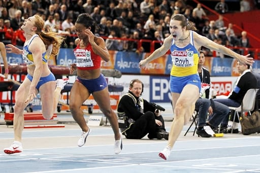 Ukraine's Oleya Povh (R) runs to win the women's 60m final along with Norway's Ezinne Okparaebo (C) and Ukraine's Hrystyna Stuy (L) at the European Athletics indoor championships in Paris March 6, 2011. REUTERS/Charles Platiau (FRANCE - Tags: SPORT ATHLETICS)